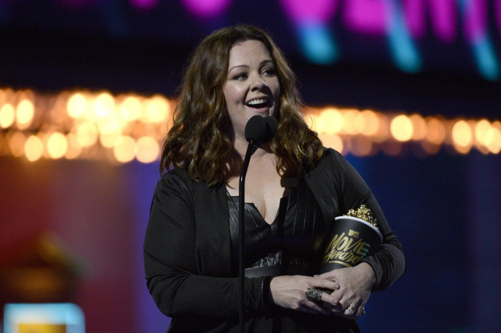Melissa McCarthy takes the stage to accept the Comedic Genius Award during the 2016 MTV Movie Awards in Los Angeles