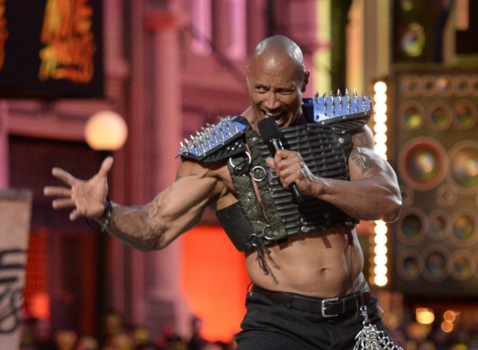 Host Dwayne Johnson takes the stage in this pool photo during the 2016 MTV Movie Awards in Los Angeles