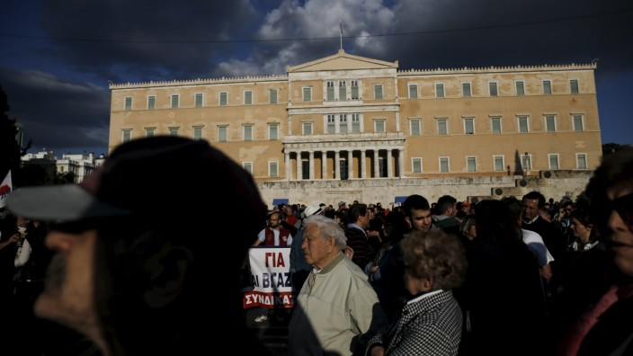 Protesters from the Communist-affiliated trade union PAME take part in a demonstration against unemployment in front of the parliament building in Athens