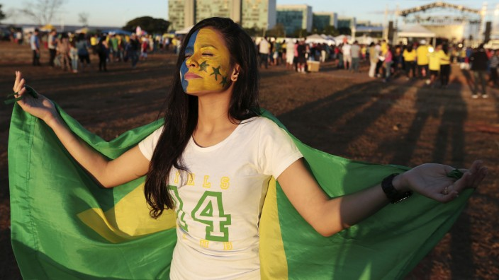 An evangelical Christian is pictured as they march during the 'Jesus Parade' in downtown Brasilia