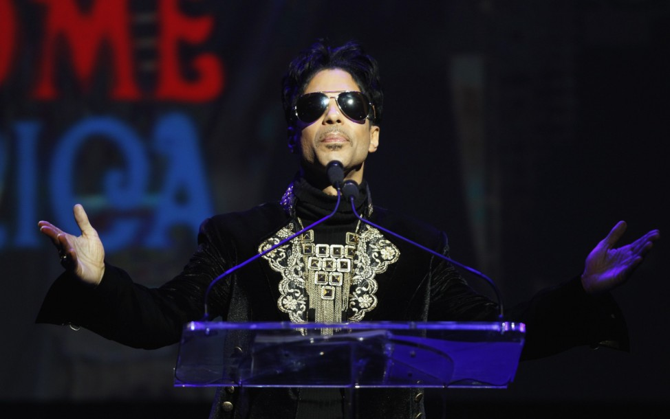 Singer Prince gestures as he announces upcoming live dates at the Apollo Theater in New York