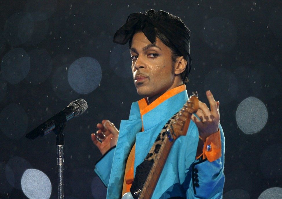 Prince performs during the halftime show of the NFL's Super Bowl XLI football game in Miami