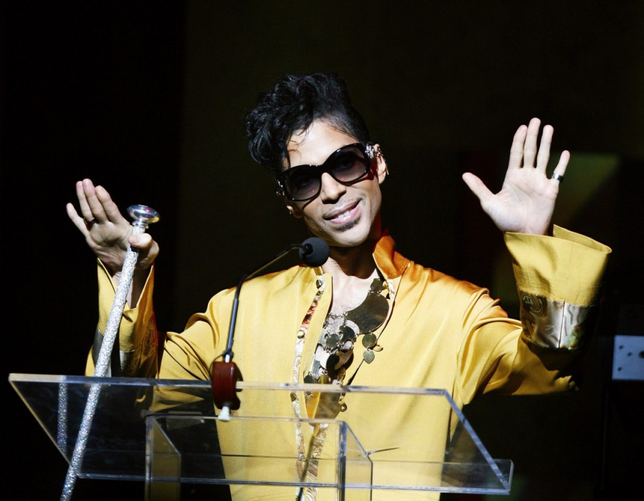 Musician Prince gestures on stage during Apollo Theatre's 75th anniversary gala in New York
