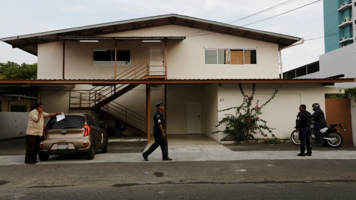 Police officers stand outside a raided property used by Mossack Fonseca, the law firm in Panama City, Panama
