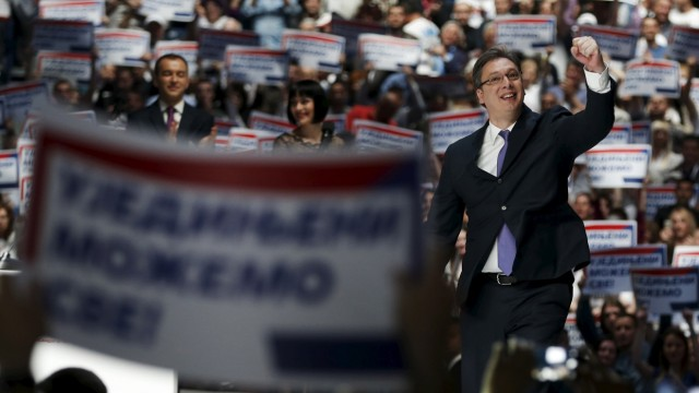 Serbian Prime Minister and leader of the Serbian Progressive Party (SNS) Vucic gestures during a rally ahead of Sunday's election, in Belgrade