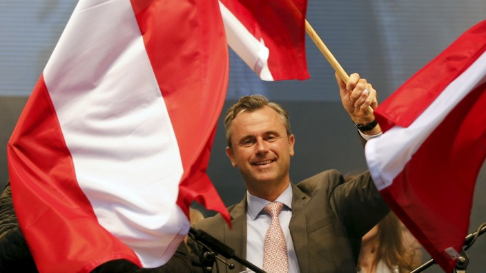 Austrian Freedom Party (FPOe) presidential candidate Hofer waves with the Austrian flag in Vienna
