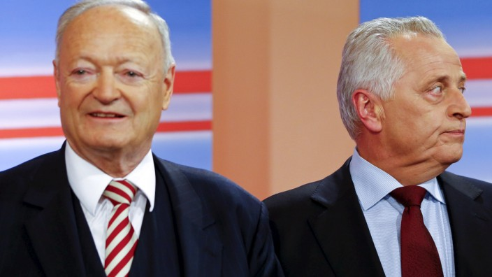 Presidential candidates Kohl and Hundstorfer react during a TV debate in Vienna