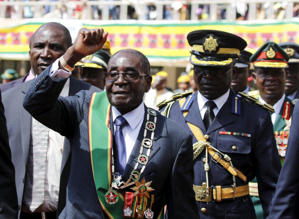 Zimbabwe's President Mugabe gestures as he arrives to address Zimbabwe's Independence Day celebrations in Harare