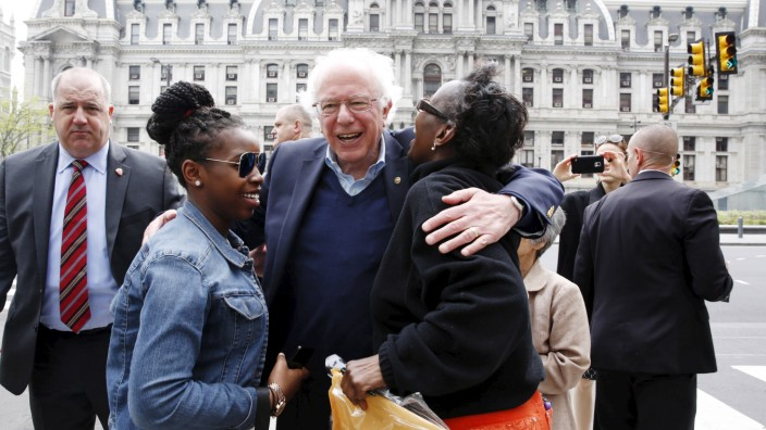 Sanders greets voters near City Hall on primary election day in Philadelphia