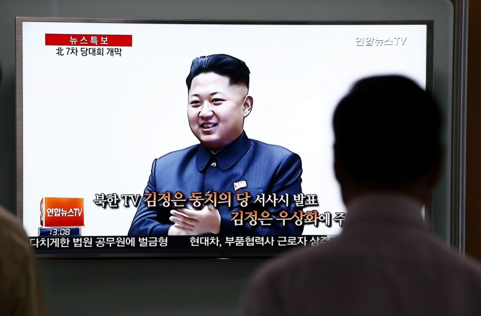 South Koreans watch TV news about North Korea's Workers Party of