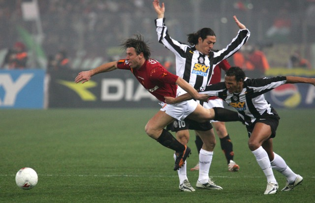 A.S. Roma's Cassano is tackled by Zebina of Juventus during their Serie A soccer match at Olympic stadium in Rome