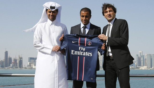 Brazil's Moura, newly signed player for French soccer club Paris St Germain, poses with  the club's President al-Khelaif and Sports Director Leonardo in Doha
