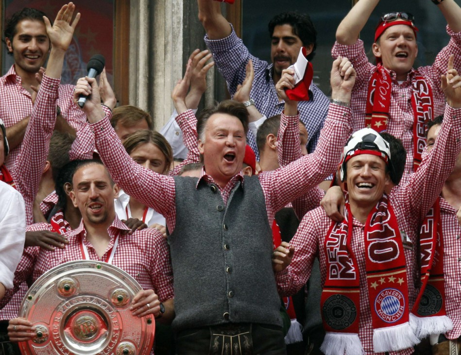 Munich's coach Louis van Gaal celebrates the German soccer championship trophy during a reception at the balcony of Munich's townhall