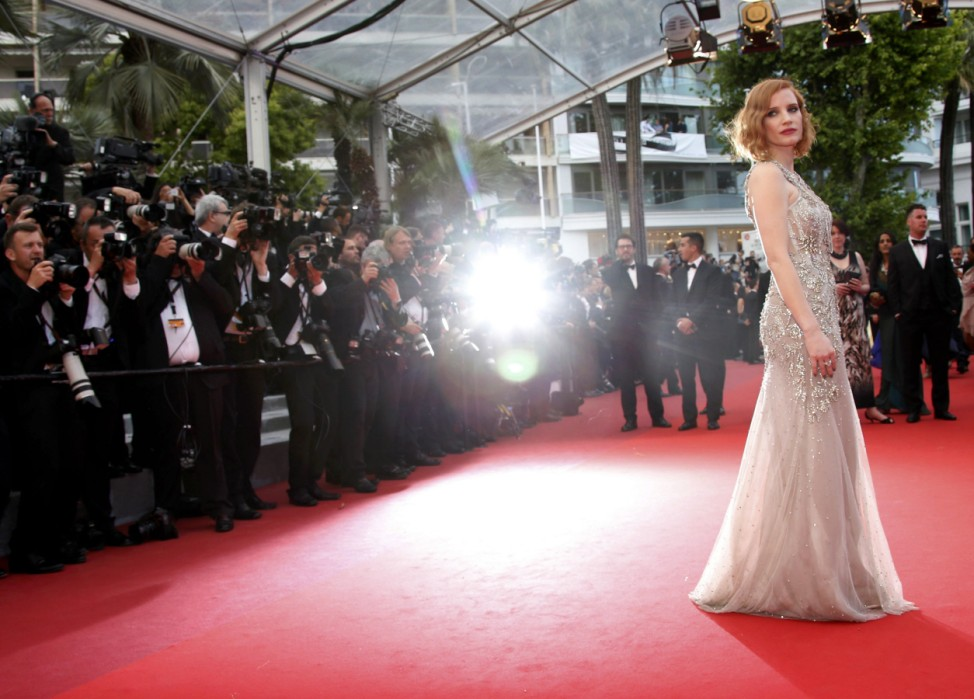 Actress Jessica Chastain poses on the red carpet as she arrives for the screening of the film 'Money Monster' out of competition during the 69th Cannes Film Festival in Cannes
