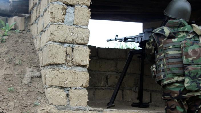 Azeri serviceman aims his weapon at frontline with self-defense army of Nagorno-Karabakh in Azerbaijan