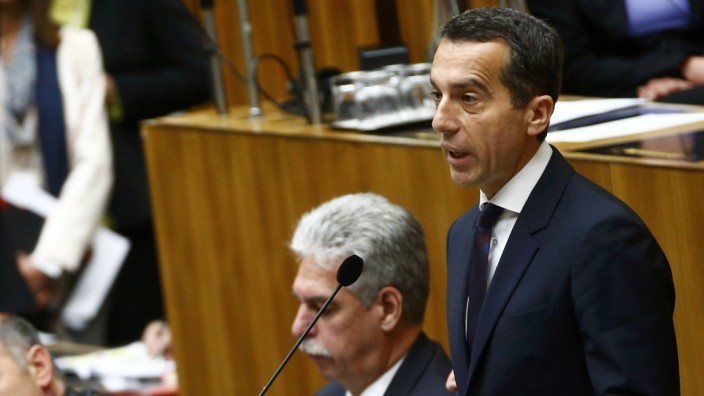 Austria's Chancellor Kern delivers a speech next to Finance Minister Schelling and Interior Minister Sobotka during a session of the parliament in Vienna
