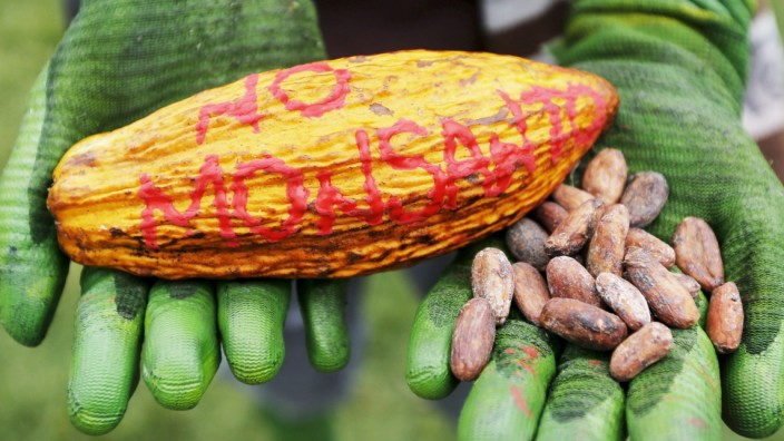 Demonstrator take part during a protest against Monsanto Co in Bogota