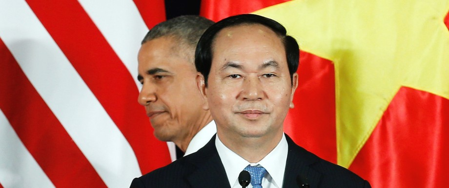 U.S. President Barack Obama attends a press conference with Vietnam's President Tran Dai Quang at the Presidential Palace Compound in Hanoi, Vietnam