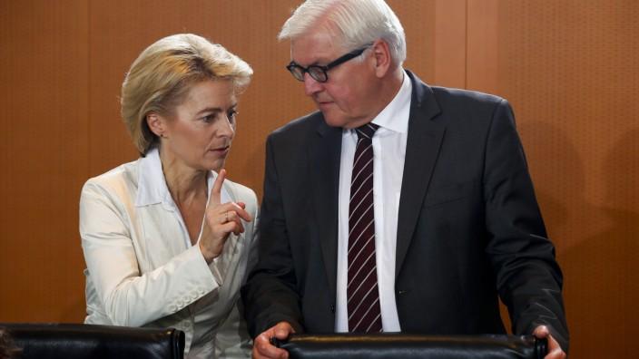 German Defence Minister von der Leyen talks with Foreign Minister Frank-Walter Steinmeier before cabinet meeting at Chancellery in Berlin