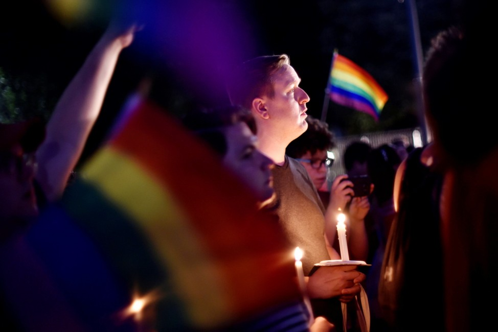 People gather outside the White House for a vigil on Pennsylvania Avenue later in the day of the worst mass shooting in U.S. history at a gay nightclub in Orlando
