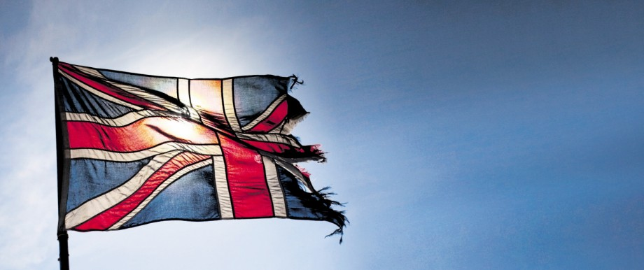 Torn Union Jack flag flying