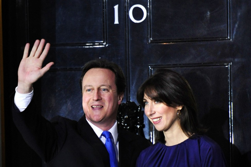 Britain's incoming Prime Minister Cameron waves in front of 10 Downing Street in London