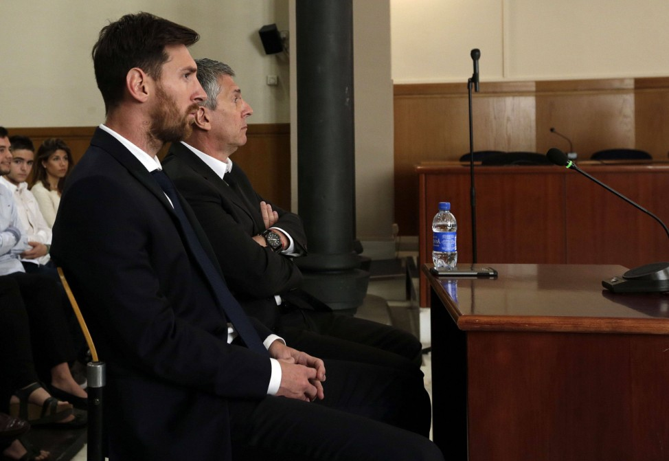 Argentine soccer player Lionel Messi L and his father Jorge Horacio Messi R attend their trial
