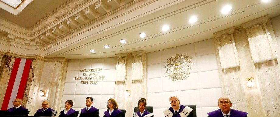 Members of Austria's constitutional court and Chief Justice Holzinger wait for the start of a court session in Vienna