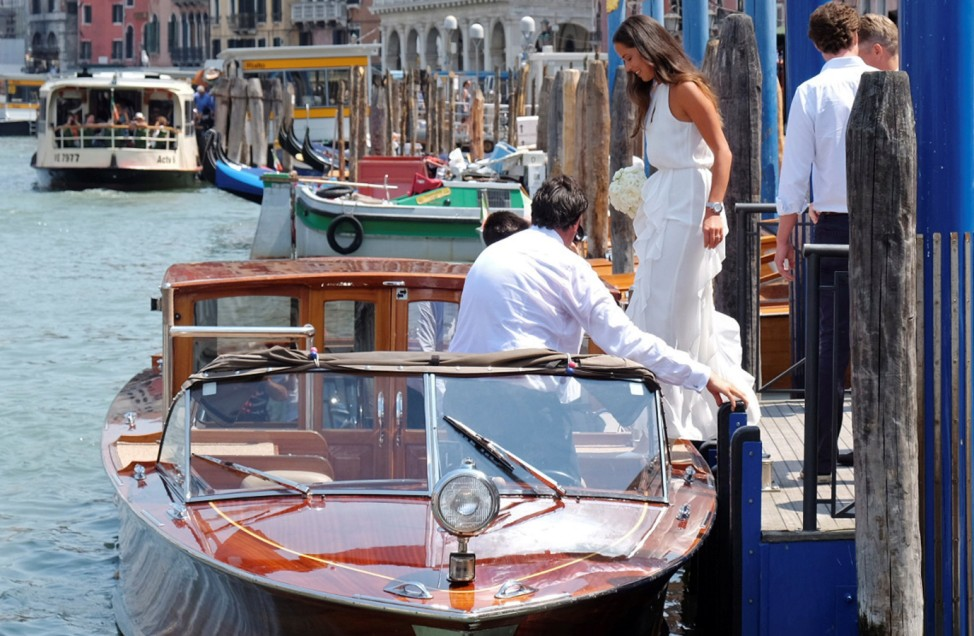 Serbian tennis player Ivanovic boards a boat following the wedding ceremony with German football player Schweinsteiger in Venice