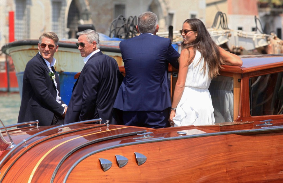 German football player Schweinsteiger and Serbian tennis player Ivanovic stands in a boat after getting married in Venice
