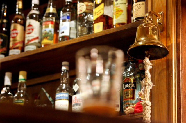 A traditional 'last orders' bell is seen behind the bar at The Speaker pub in Victoria central London