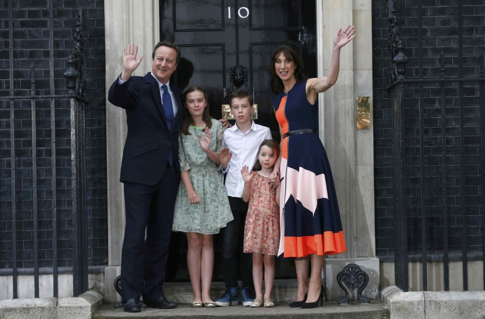 Britain's outgoing Prime Minister, David Cameron and his family pose for photographs in front of number 10 Downing Street, in central London