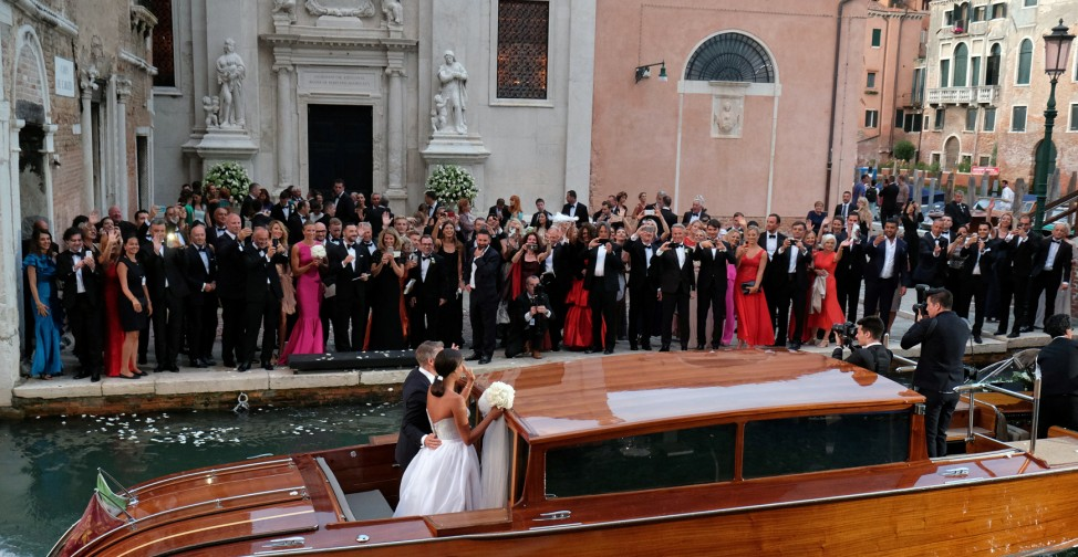 German football player Schweinsteiger and Serbian tennis player Ivanovic wave from a boat following the wedding ceremony in a church in Venice