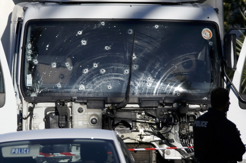 Bullet imacts are seen on the heavy truck the day after it ran into a crowd at high speed killing scores celebrating the Bastille Day July 14 national holiday on the Promenade des Anglais in Nice