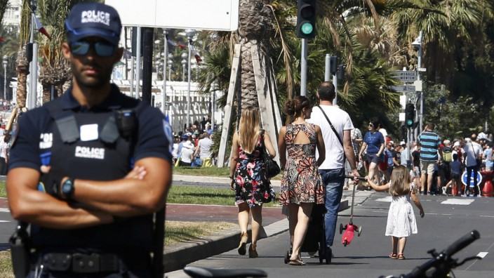 A French municipal policeman stands guard days after the Bastille Day truck attack by a driver who ran into a crowd on the Promenade des Anglais that killed scores and injured as many, in Nice