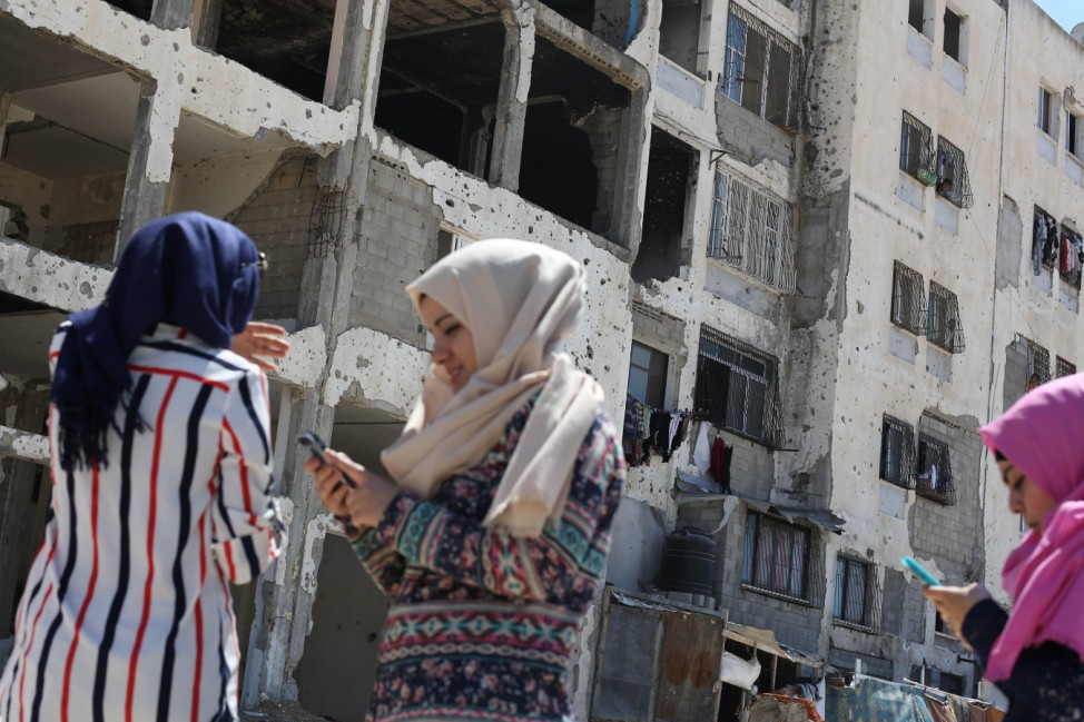 July 14 2016 Gaza Gaza strip Palestine Girls in Gaza on 14 July 2016 playing Pokemon game sea