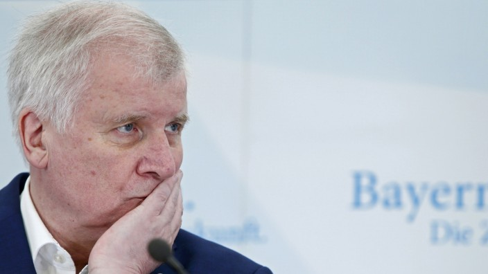 Bavarian state premier and leader of the CSU Seehofer attends a news conference in Sankt Quirin