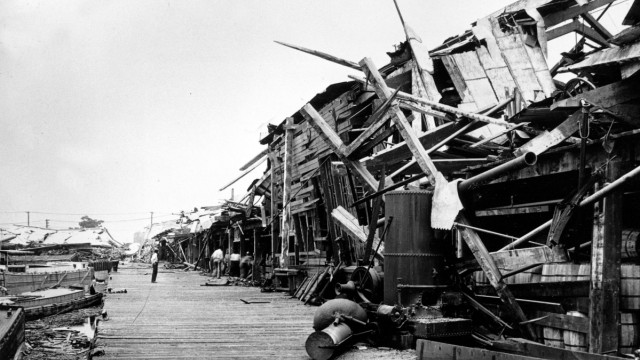 This view shows the ruins on the pier following the explosion of a munition...