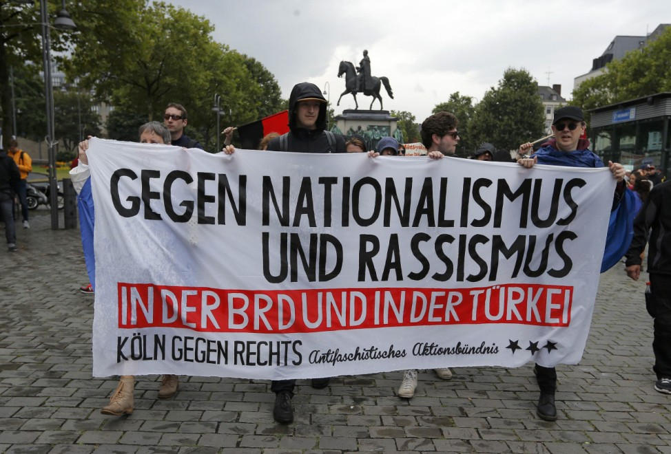 Protesters against Turkish President Erdogan walk during a pro-government protest in Cologne
