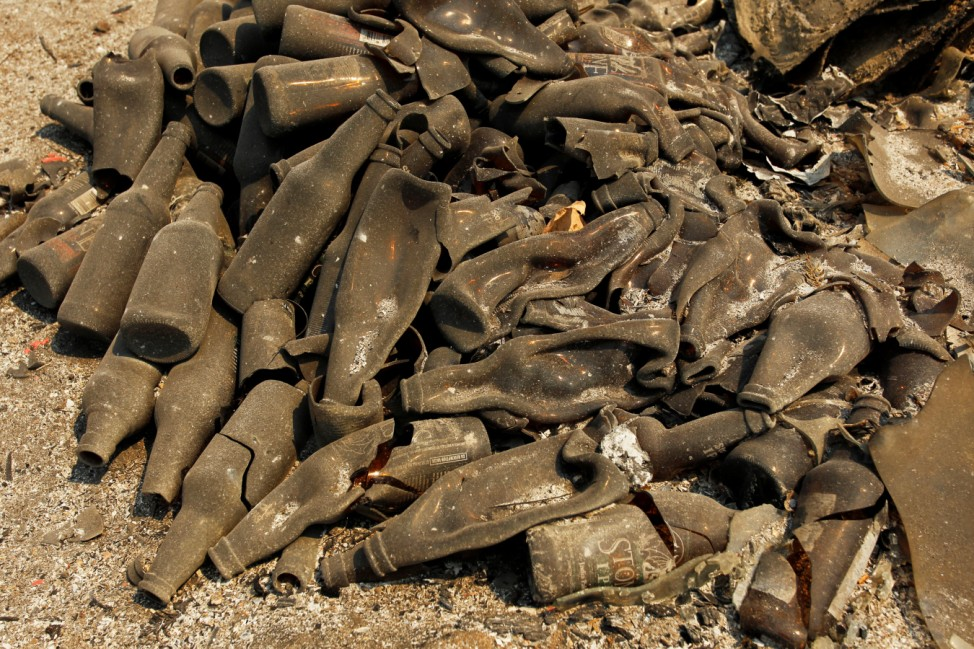 A pile of melted bottles lay on the ground at the site of a destroyed home after the Soberanes Fire burned through the Palo Colorado area, north of Big Sur, California