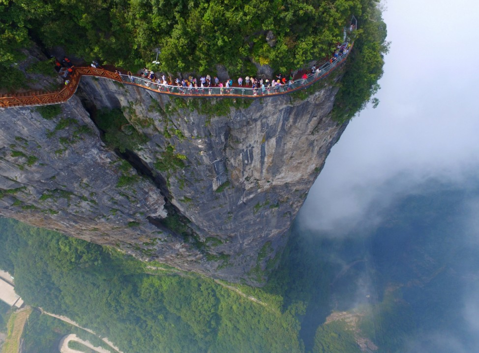 People walk on a sightseeing platform in Zhangjiajie, Hunan Province, China
