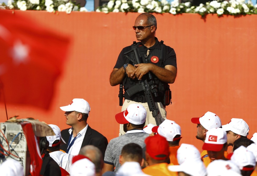 A security officer observes during the Democracy and Martyrs Rally in Istanbul