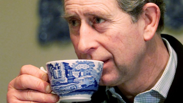 BRITAIN'S PRINCE OF WALES DRINKS TEA AT A GUEST HOUSE IN THE LAKE DISTRICT