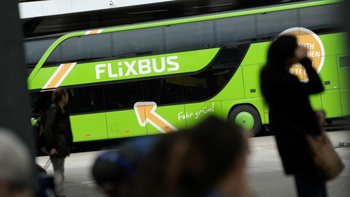 Passengers walk near Flixbus bus at main bus station in Berlin
