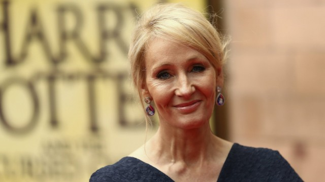 Author J.K. Rowling poses for photographers at a gala performance of the play Harry Potter and the Cursed Child parts One and Two in London