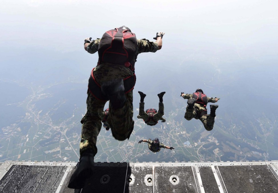 Air force instructors conduct a HALO jump