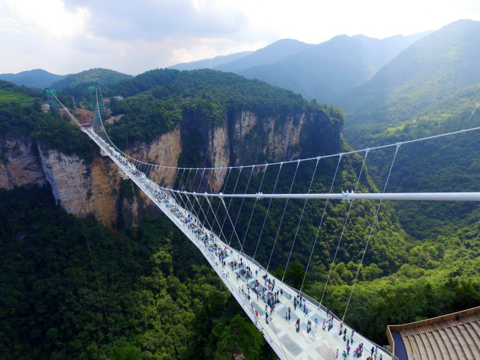 Longest and the highest glass bridge in the world begins trial op
