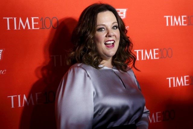Actress Melissa McCarthy poses for photographers on the red carpet as she arrives for the TIME 100 Gala in Manhattan, New York