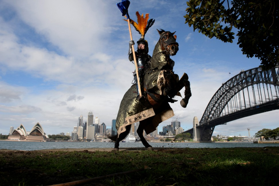 Two-time World Medieval Jousting champion Rod Walker poses for a photograph on his horse 'Crusader' in Sydney