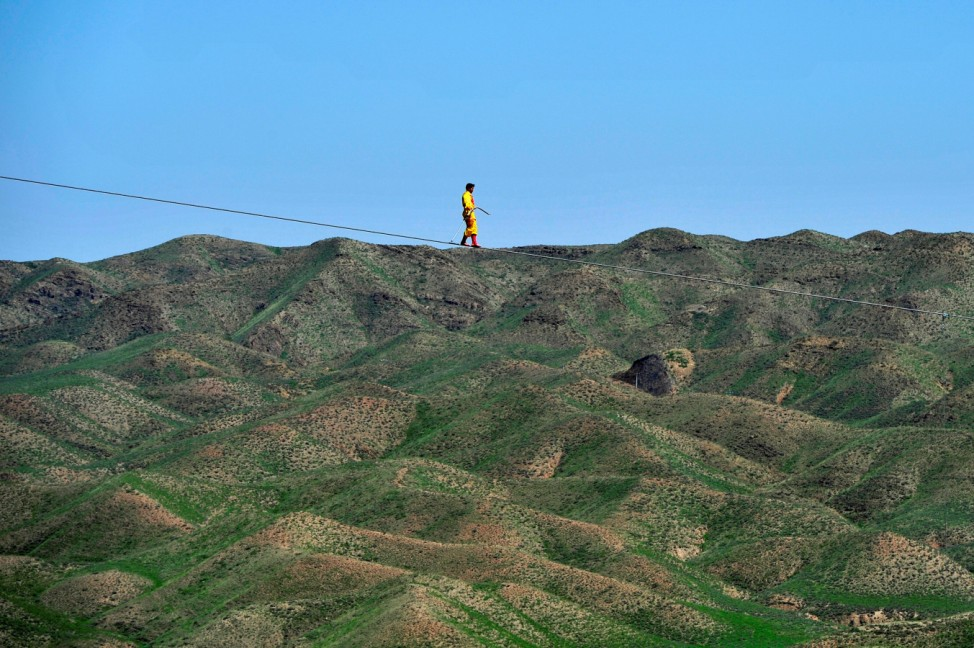 A man performs as he walks on a tightrope in Qingtongxia